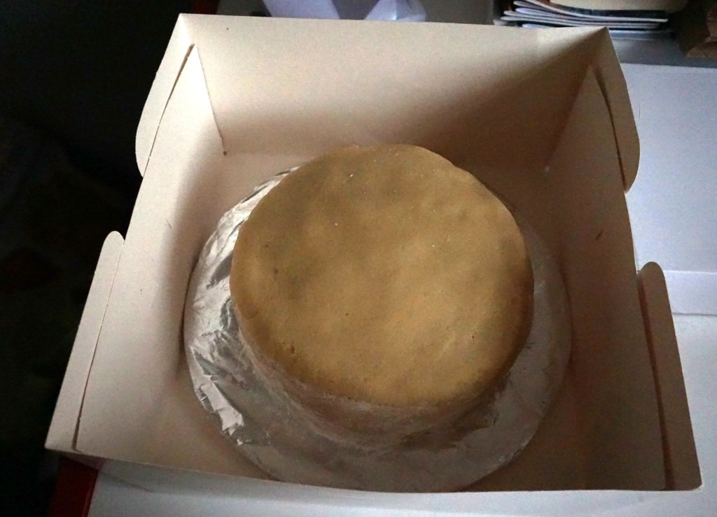 cake in box for almond paste to dry
