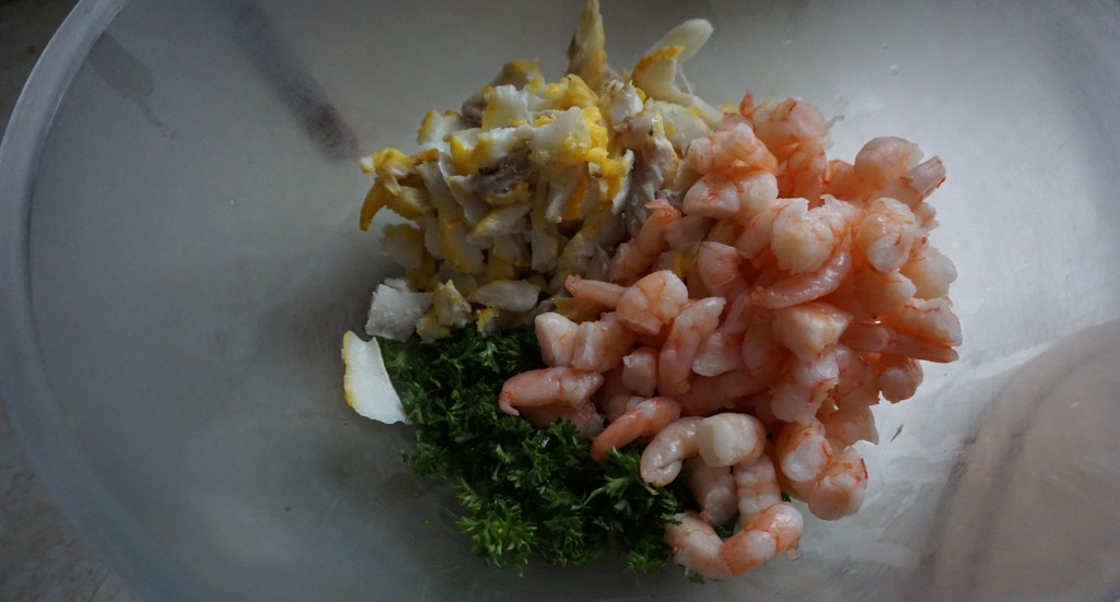 Add flaked fish, prawns and parsley to bowl
